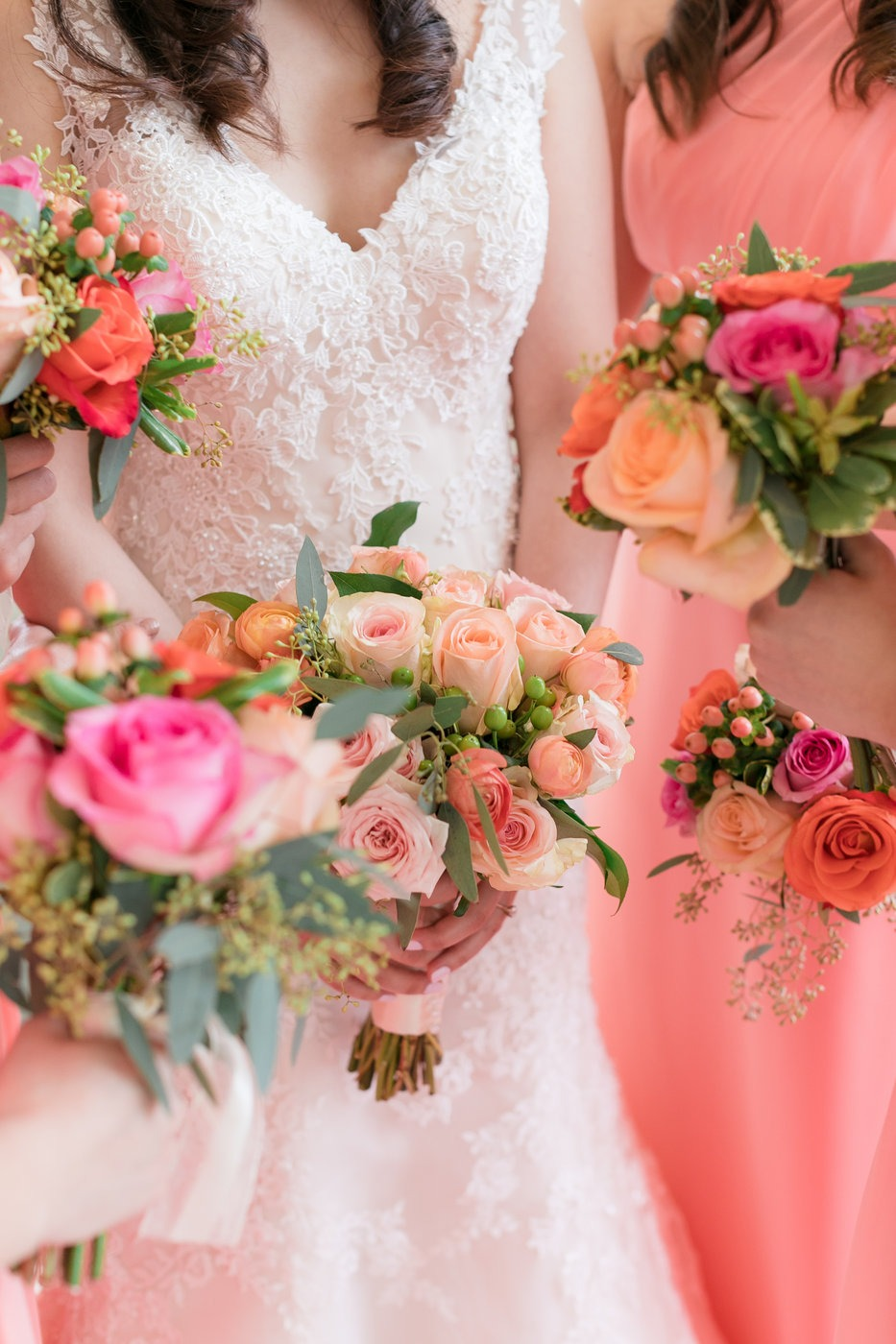 Bride and bridesmaids with gorgeous floral arrangements