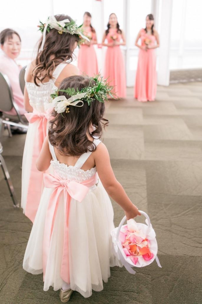 Wedding flower girl with flowers