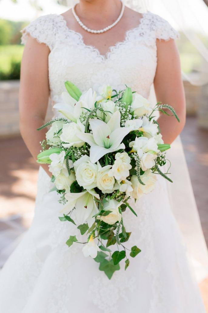 Bride with floral arrangement in Solon, Iowa