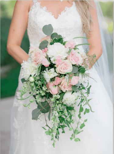 Bride with her beautiful bouquet floral arrangement
