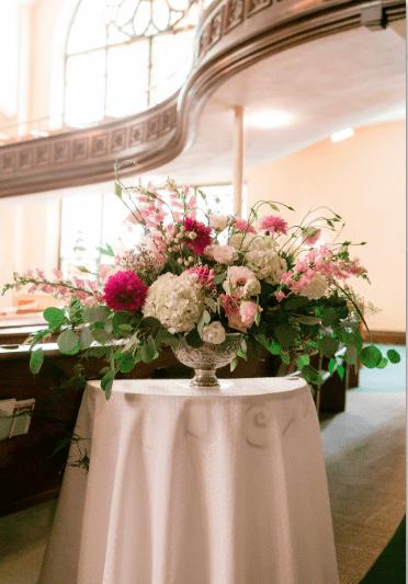 Beautiful wedding and flower arrangement in Iowa City church